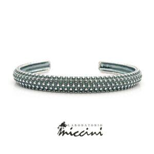 Bracciale rigido puntinato in argento