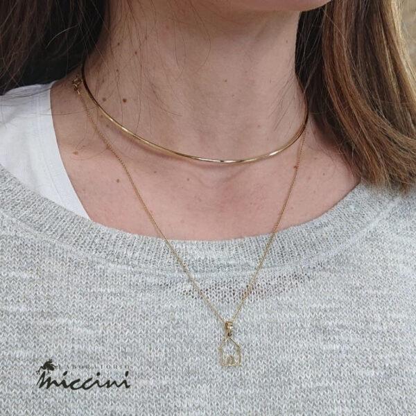 girocollo rigido in argento dorato